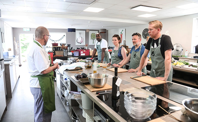 image of the cookery school people listening to chef