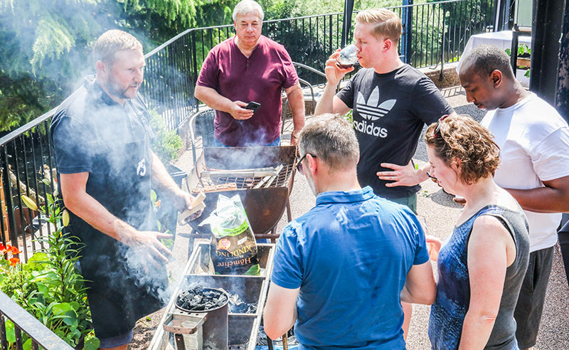 image of people at the bbq cookery class at food sorcery didsbury Manchester near Cheshire