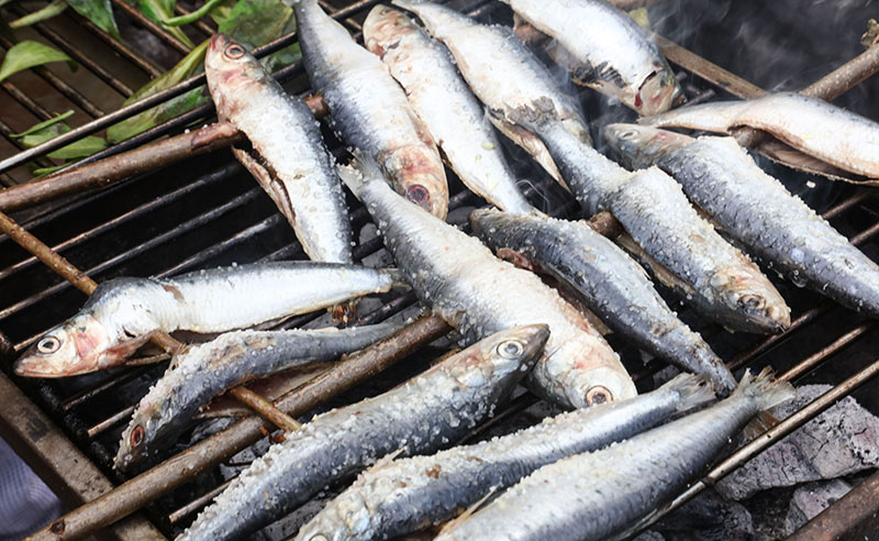 image of sardines cooking on the bbq class