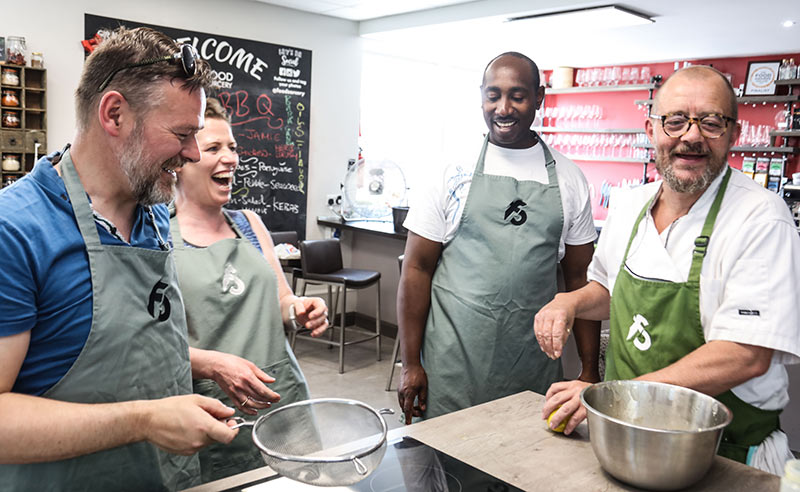 image of people laughing at the cookery school Manchester