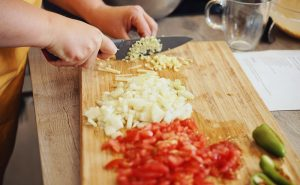 image of Farzana Ullah chopping at Indian cookery classes at the cookery school Manchester near Cheshire