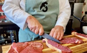 image of steak masterclass slicing beef at the cookery school manchester