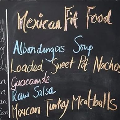 image of black board displaying menu for mexican cookery class