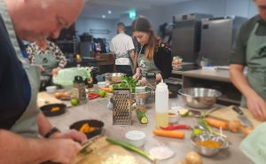 image of people chopping vegetables at the cooking school manchester