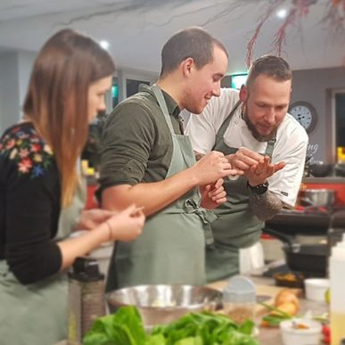 image of people attending a cookery lesson at the cookery school manchester near wilmslow cheshire