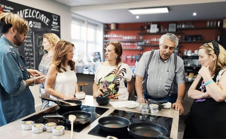 image of guests at the cookery school manchester cooking together near wimslow cheshire