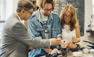 image of people grinding spices at the cookery school manchester near wilmslow cheshire