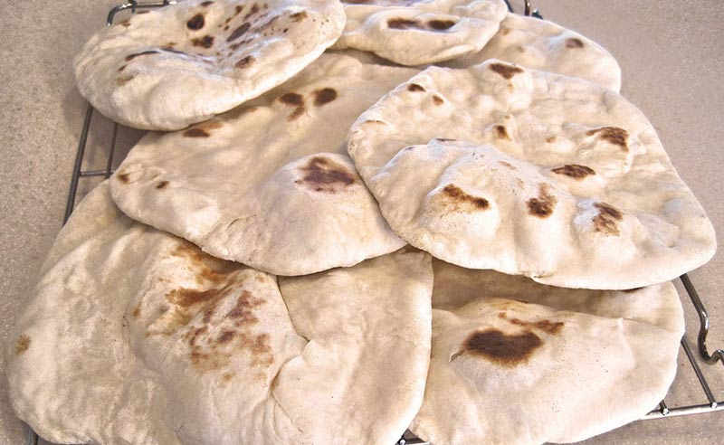 image of flat bread cooling on a rack