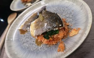 image of sea bass on top of red rice and spinach from cooking together