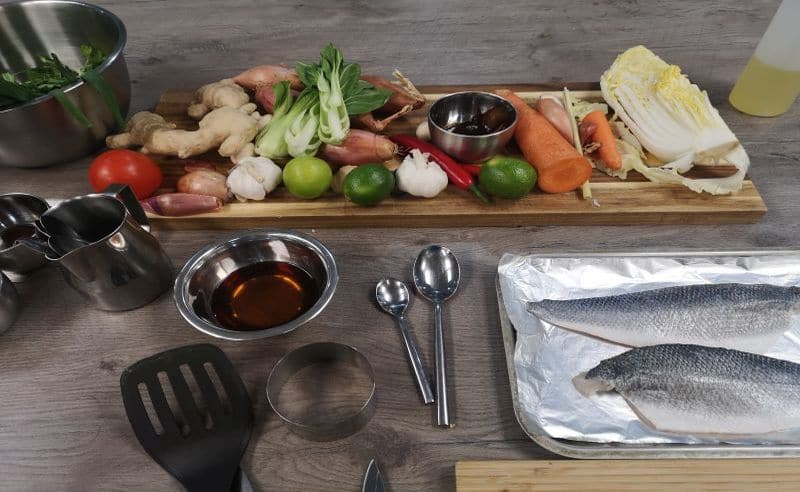 image of vegetables and sea bass fillets from cooking together