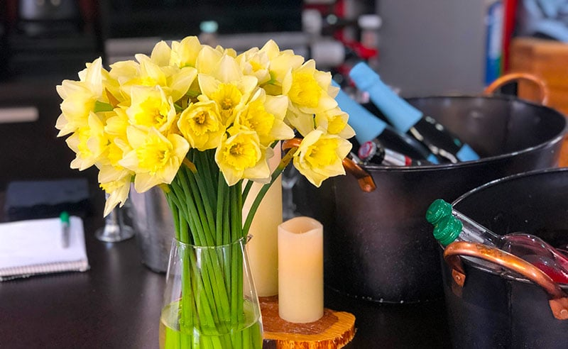 image of daffodiles and prosecco for mothers day cokery experiences