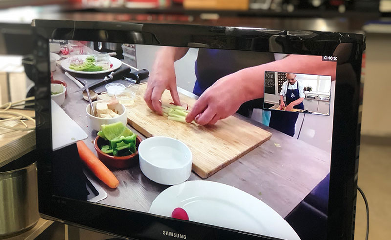 image of online cookery class manchester team building hands