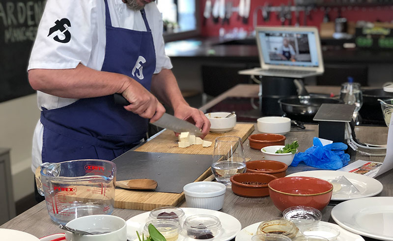 image of Jason Palin chopping at the cookery school