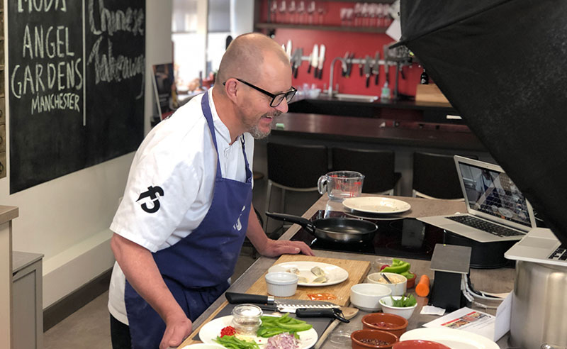 image of chef laughing at the cookery school manchester