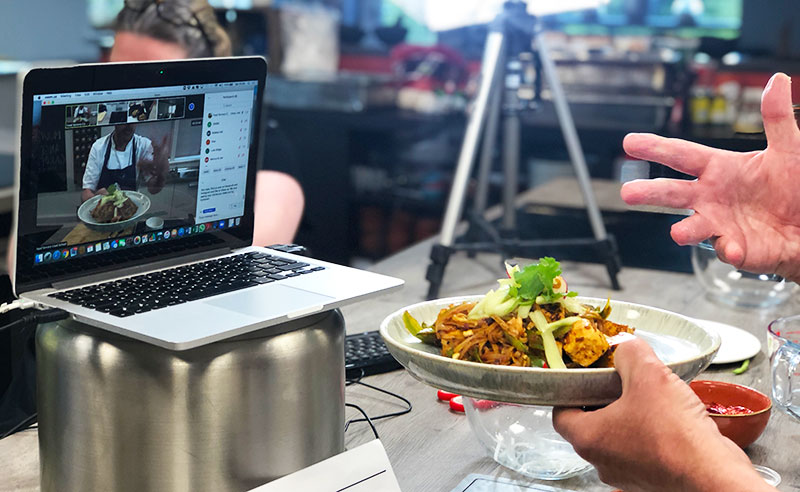 image of online cookery class plate and laptop