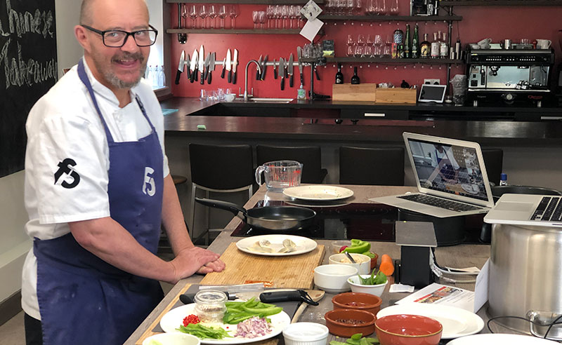 image of online cookery class chef smiling
