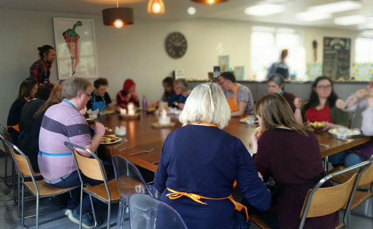 image of guests dining at food sorcery vegan cookery day