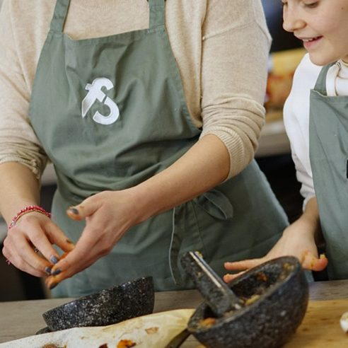 image of parent and child cooking together at big and little cooks cookery school